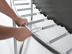 Installing a trampoline spring