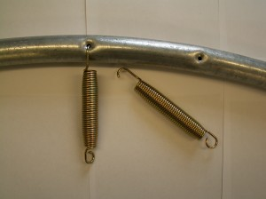 Spring used for frame with round hole (note elongated hook end)